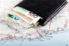 European union currency in a wallet on a map background. Travel concept Stock Photos