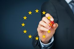 European union disintegration. Concept. Politician populist cross out star from EU symbol brexit, grexit, czexit, frexit, italexit and similar Stock Images