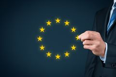 European union disintegration. Concept. Politician populist remove star from EU symbol brexit, grexit, czexit, frexit, italexit and similar Royalty Free Stock Photo