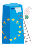 European union election. A voter with a sheet of paper in his hand climbs up a ladder to the top of a votebox Stock Photo