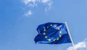European Union EU flag against a blue sky. Soon there will be one less star since the UK voted to leave the EU in 2016,. European Union EU flag against a blue Stock Photography