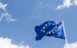 European Union EU flag against a blue sky. Soon there will be one less star since the UK voted to leave the EU in 2016,. European Union EU flag against a blue Stock Photo