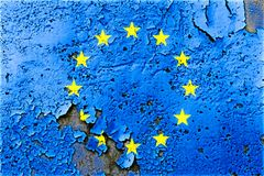 European Union EU flag painted on cracked wall with peeling paint concept for EU political crisis. European Union EU flag painted on cracked wall with peeling stock photo
