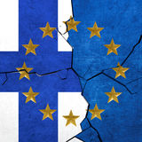 European union and Finland flags. Breaking apart Stock Photo