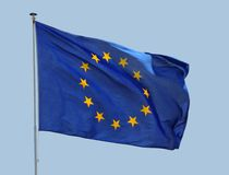 European Union Flag. Fluttering in a brisk breeze against a blue sky Royalty Free Stock Image