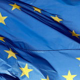 European Union Flag. Flag of European Union blowing in wind or breeze Royalty Free Stock Image