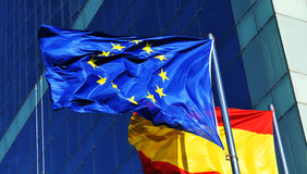 European Union flag. European Union and Spanish flags in front of corporate building Royalty Free Stock Images