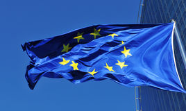 European Union flag. In front of corporate building Stock Photos
