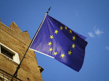European Union Flag. In a sunny day on blue and clean sky. Emblem of EU and Council of Europe Stock Photos