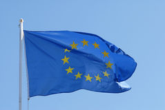 European Union flag. Flag of European Union, waving, isolated over blue sky royalty free stock photo