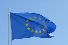European Union flag. Flag of European Union, waving, isolated over blue sky Royalty Free Stock Photo