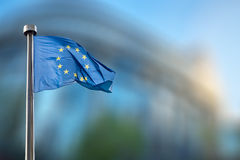 European Union flag against European Parliament Stock Photos