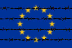 European Union flag behind barbed wires Royalty Free Stock Photo