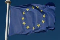 European Union Flag, a Blue sky background. Stock Photos