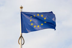 European union flag on blue sky Stock Images