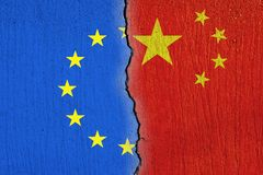 European Union flag  and Chinese flag painted on cracked wall , EU and China relations stock photos