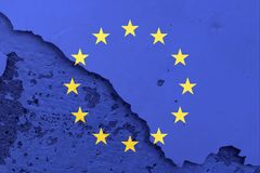 European Union flag on cracked wall texture background. Stock Photos