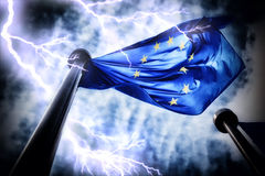 European Union flag on dark thunderstorm sky background Stock Photos