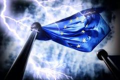 European Union flag on dark thunderstorm sky background. Closeup shot stock photos