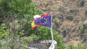 European Union Flag And Flag Of Spain stock footage