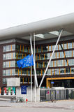 European Union Flag flies at half-mas Agora building. STRASBOURG, FRANCE - 14 Nov 2015: European Union Flag flies at half-mast in front of the Counci lof Europe Royalty Free Stock Images