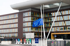 European Union Flag flies at half-mas Agora building. STRASBOURG, FRANCE - 14 Nov 2015: European Union Flag flies at half-mast in front of the Counci lof Europe Royalty Free Stock Photography