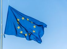 European Union flag flying in front of bright blue sky. European Union flag flying in front of bright blue sky Royalty Free Stock Image