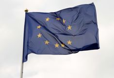 European Union flag flying in front of bright blue sky.  royalty free stock photo