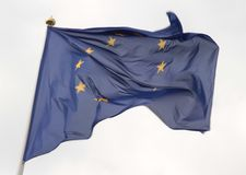 European Union flag flying in front of bright blue sky.  royalty free stock image