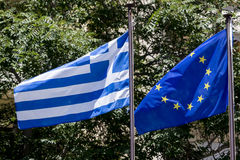 European Union flag and Greek flag, waving in the wind Royalty Free Stock Images