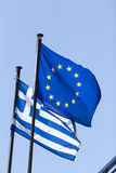 European Union flag and Greek flag, waving in the wind Stock Photos