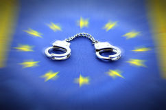 European Union flag and handcuffs Stock Image