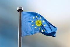 European Union flag with molecule of Coronavirus inside round from stars.