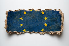 European union flag on torn cardboard. European union flag on cardboard piece Royalty Free Stock Photography