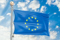European Union flag waving in blue cloudy sky, 3D rendering Royalty Free Stock Photos