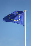 European Union flag on wind. Against blue sky Royalty Free Stock Photos