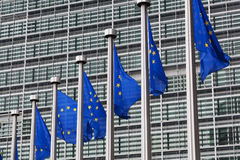 European Union flags. Against the European Parliament building Royalty Free Stock Photo