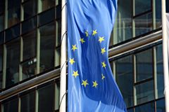 European union flags, flying and waving Royalty Free Stock Image