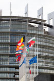 European Union Flags and France flag flies at half-mast. STRASBOURG, FRANCE - 14 Nov 2015: European Union Flags and France flag flies at half-mast in front of Stock Photo