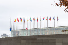 European Union Flags and France flag flies at half-mast. STRASBOURG, FRANCE - 14 Nov 2015: European Union Flags and France flag flies at half-mast in front of Royalty Free Stock Photo