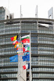 European Union Flags and France flag flies at half-mast. STRASBOURG, FRANCE - 14 Nov 2015: European Union Flags and France flag flies at half-mast in front of Stock Images