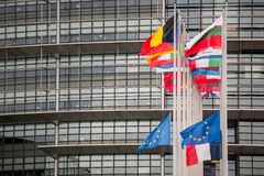 European Union Flags and France flag flies at half-mast. STRASBOURG, FRANCE - 14 Nov 2015: European Union Flags and France flag flies at half-mast in front of Royalty Free Stock Images