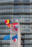 European Union Flags and France flag flies at half-mast. STRASBOURG, FRANCE - 14 Nov 2015: European Union Flags and France flag flies at half-mast in front of Stock Photos