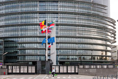 European Union Flags and France flag flies at half-mast. STRASBOURG, FRANCE - 14 Nov 2015: European Union Flags and France flag flies at half-mast in front of Royalty Free Stock Photography