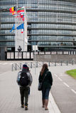 European Union Flags and France flag flies at half-mast. STRASBOURG, FRANCE - 14 Nov 2015: Tourists admiring as European Union Flags and France flag flies at Royalty Free Stock Photography