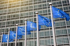 European Union flags in front of the Berlaymont Royalty Free Stock Photography