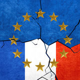 European union and French flags. Breaking apart Royalty Free Stock Photo
