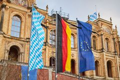European Union, German and Bavarian flag. On a flag poles Royalty Free Stock Images