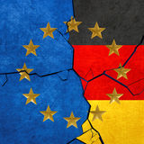 European union and German flags. Breaking apart Royalty Free Stock Image