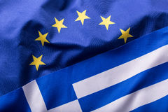 European Union and Greece. The concept of relationship between EU and Greece. Waving flag of EU and Greece Royalty Free Stock Image